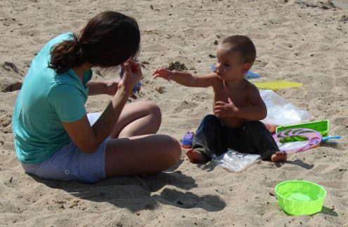 Beach scene with mom and child